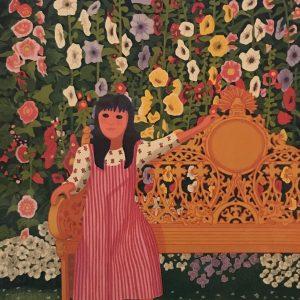 Niña en banca con Flores